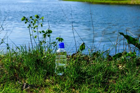Plastic bottle with clear water on rustic wooden table Stock Photo