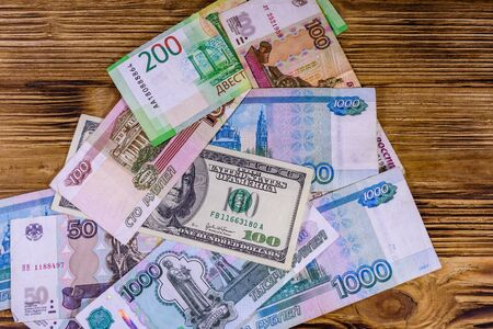 American one hundred dollars banknote on many russian rubles Stock Photo