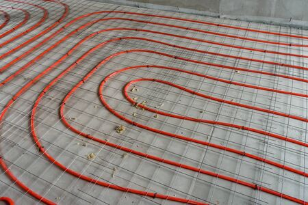 Tubes of the underfloor heating system on  insulation