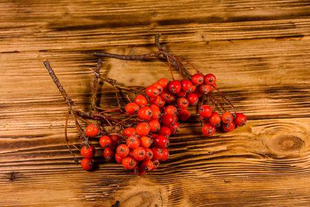 Berries of rowan tree on rustic wooden table. Top view