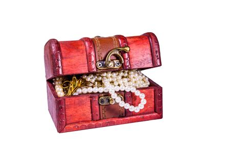 Old box of red wood full of jewelry isolated on ehite background. Treasure chest