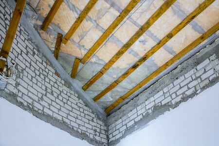 Construction of roof in new residential building. View from inside