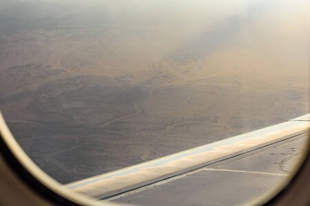 Aerial view on arabian desert and Red sea mountains from airplane window