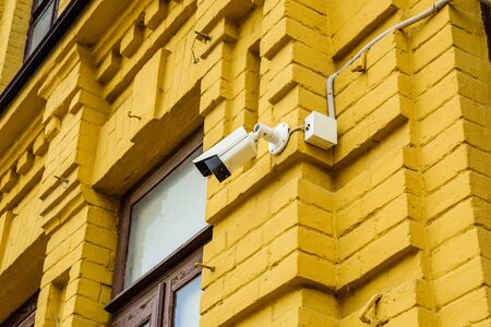 Security camera on facade of the residential building