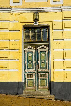 Old wooden entrance door in residential building