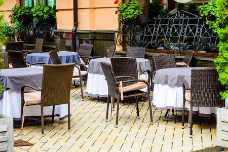 Chairs and tables in cozy street cafe