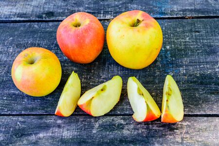 Pile of the ripe apples on rustic wooden table Reklamní fotografie