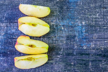 Sliced ripe apple on rustic wooden table. Top view