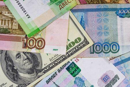 American one hundred dollars banknote on many russian rubles Reklamní fotografie