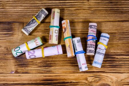 Many rolled up banknotes. Euro, american dollars, ukrainian hryvnias, egyptian pounds and russian roubles Reklamní fotografie