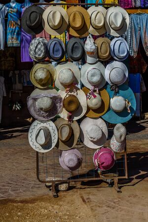 Different hats for sale in street shop