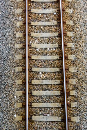 Top view of railroad tracks on gravel