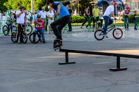 Kremenchug, Ukraine - June 05, 2017: Skater doing differenr tricks in skatepark during the festival of street culture