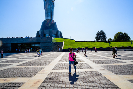 Kiev, Ukraine - August 24, 2019: People walking on territory of the memorial complex near the mother motherland monument on independence day of Ukraine