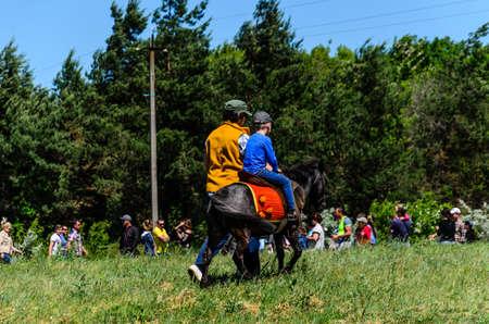 Kremenchug, Ukraine - June 3, 2017: Pony riding on a peasant fair 新聞圖片