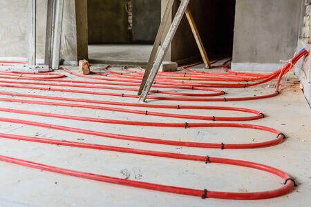 Tubes of the underfloor heating system on foam insulation