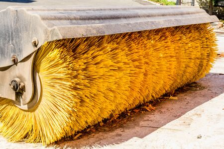 Yellow brush of the road cleaning machine