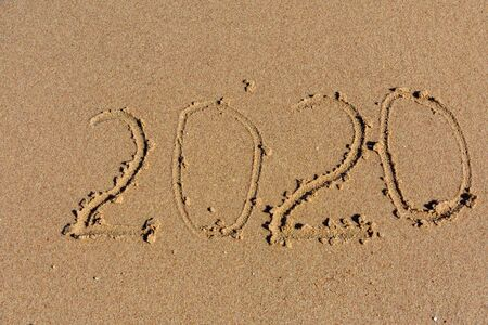 New year 2020. Inscription on sandy beach. Tropical celebration concept Stock Photo