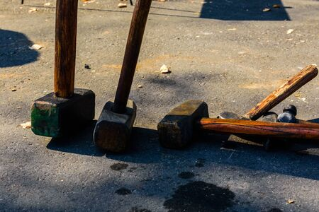 A few blacksmith hammers on the ground 写真素材