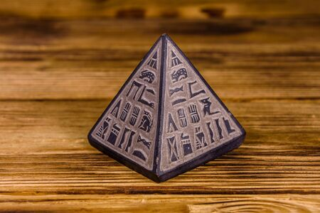 Souvenir egyptian pyramid on a wooden table