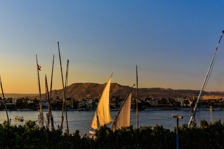 Traditional egyptian vessels feluccas on Nile river in Luxor, Egypt