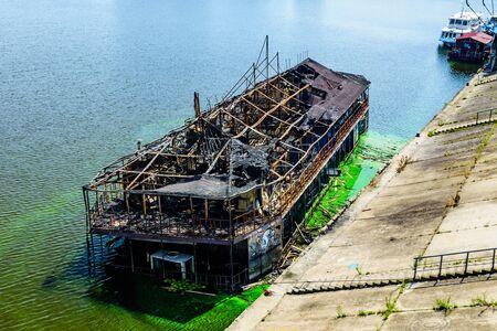 Old burnt cruise ship near bank of river dnieper in Kiev, Ukraine