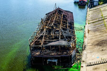 Old burnt cruise ship near bank of river dnieper in Kiev, Ukraine