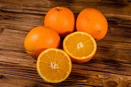 Ripe orange fruits on rustic wooden table Stockfoto