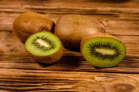 Ripe kiwi fruits on rustic wooden table