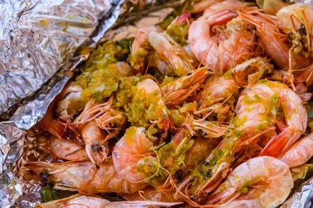 Fresh baked king shrimps with oriental herbs