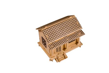 Plywood model of the house isolated on white background