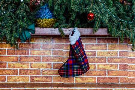 Branches of fir tree and christmas stocking