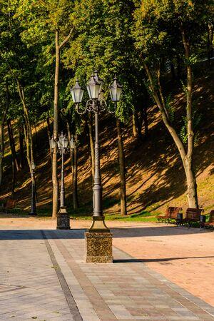 Old lantern in city park on summer