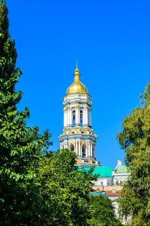 Bell tower of Kiev Pechersk Lavra against blue sky Stockfoto - 130697696