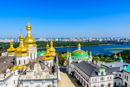 View on Dormition Cathedral and Refectory church of Kiev Pechersk Lavra, river Dnieper and Kiev cityscape