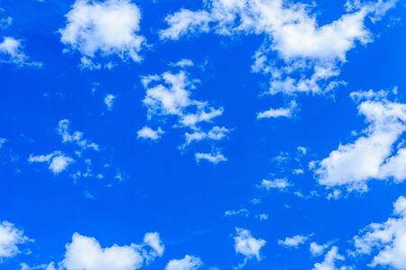 White fluffy clouds in a blue sky 写真素材