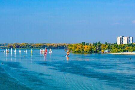 Many yachts at river Dnieper on autumn in Kremenchug, Ukraine. Sailing regatta 版權商用圖片