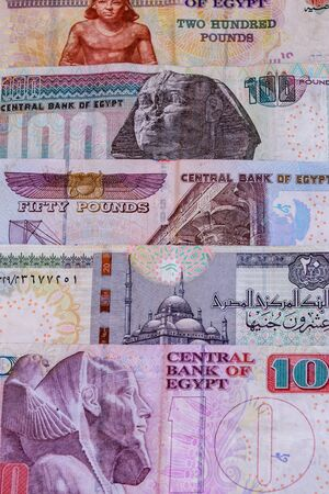 Heap of different egyptian banknotes for background Фото со стока
