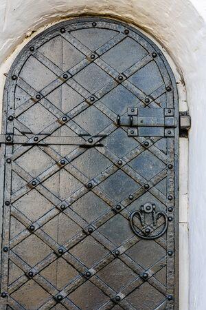 Closeup of old door with fancy pattern