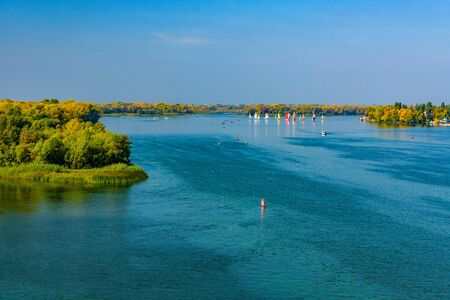 Many yachts at river Dnieper on autumn in Kremenchug, Ukraine. Sailing regatta Stok Fotoğraf