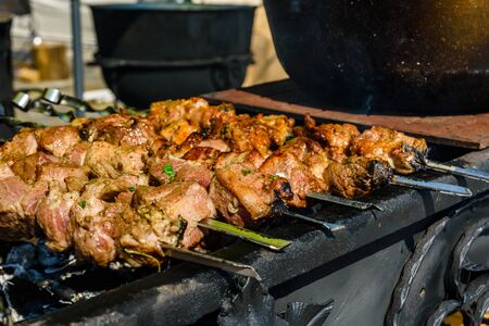 Skewers with meat over charcoals. Cooking shashlik