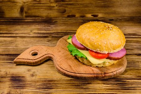 Fresh hamburger on a wooden cutting board