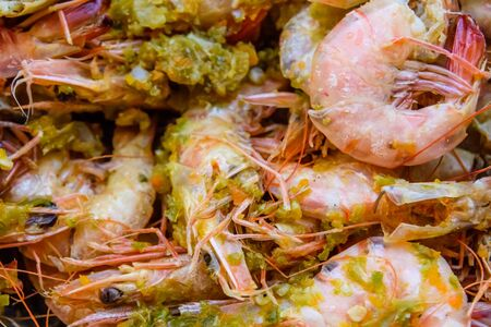 Background of the fresh boiled king shrimps with oriental herbs