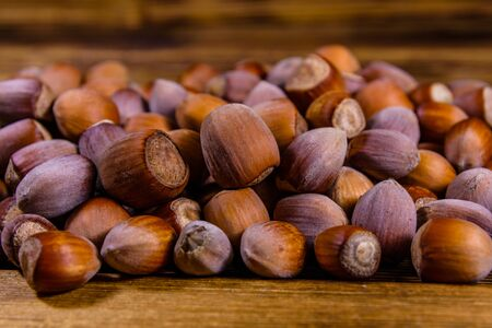 Pile of the hazelnuts on rustic wooden table
