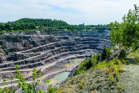 View on cliffs in a granite quarry Stock Photo