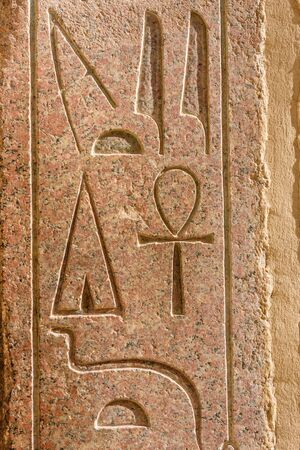 Egyptian ancient hieroglyphs on the stone wall in temple of Hatshepsut
