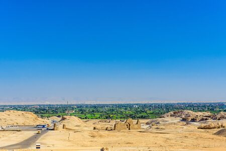 Archeological site near the temple of Hatshepsut in Luxor, Egypt. Green landscape on background