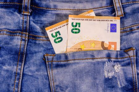 Fifty euro banknotes in pocket of blue jeans 版權商用圖片