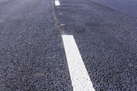 New asphalt road with white dividing strip