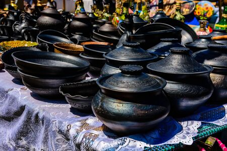 Different clay utensil for sale on country fair Фото со стока